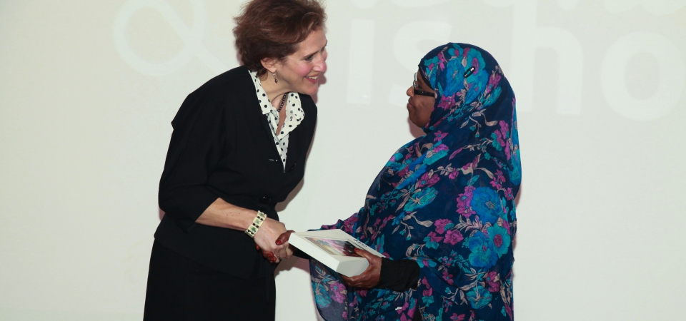 Sarah Benioff of DCLG giving the first tablet to the first Learner, Istarlin Kahiye